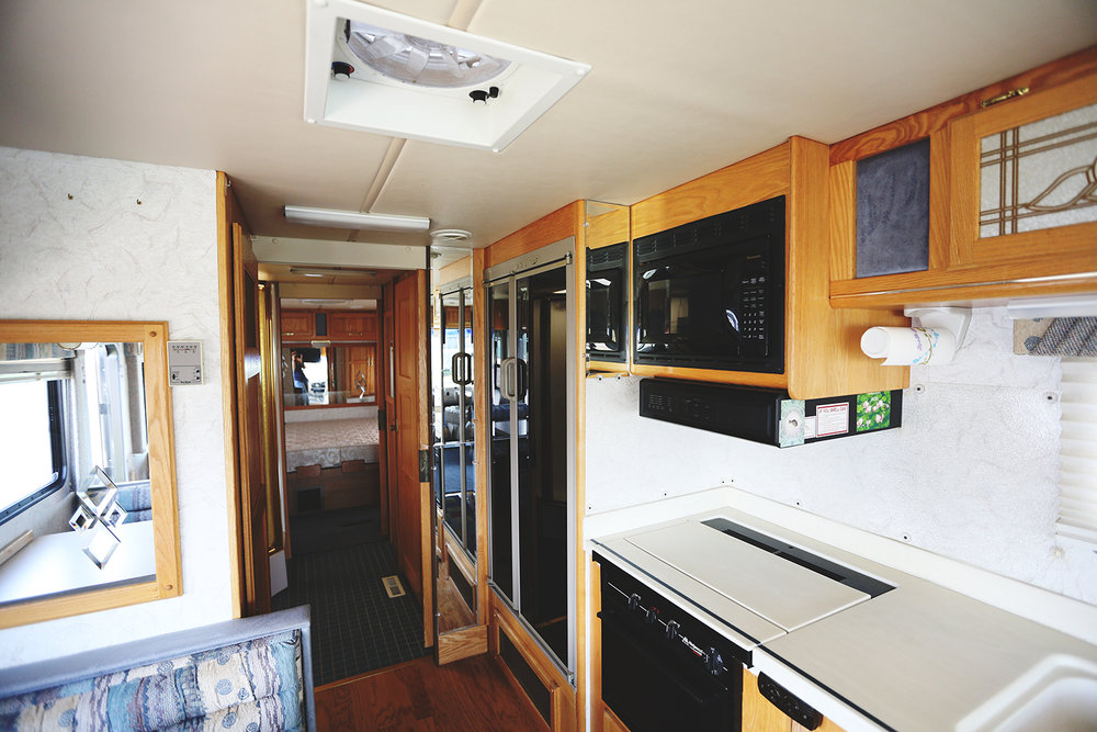 Serenica Landship: View to kitchen and bathroom suite from the booth.