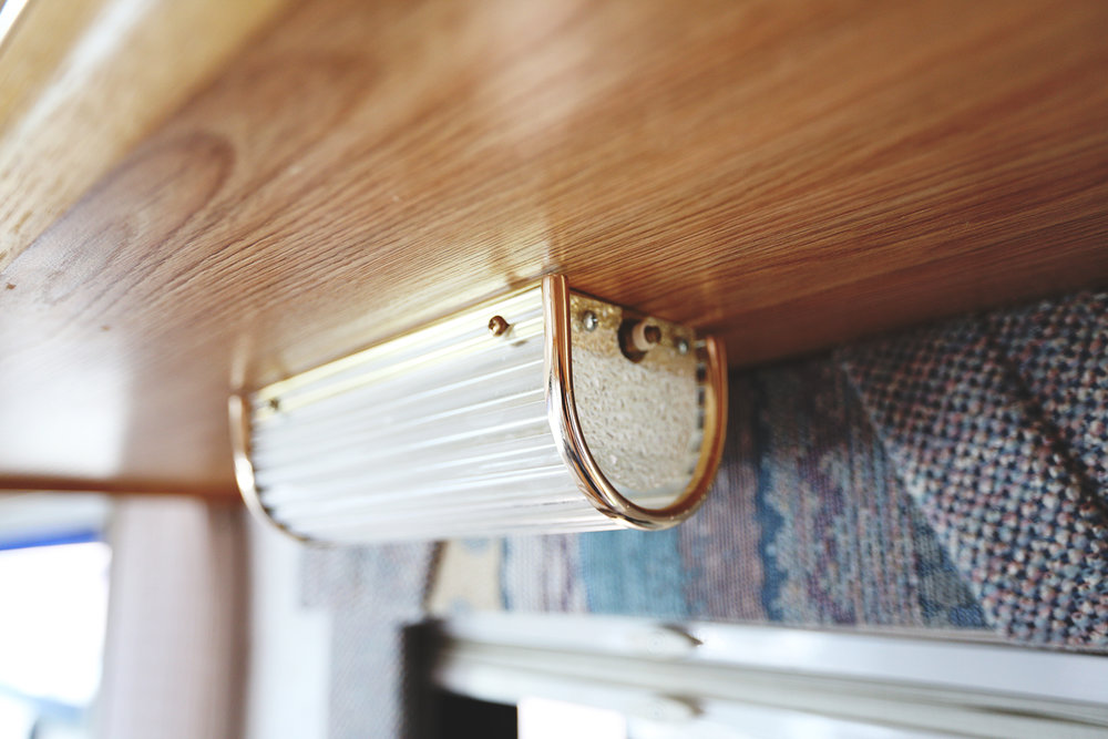 Serenica Landship: Light fixture underneath cabinetry // Detail
