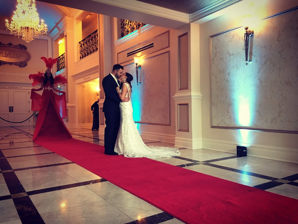 Bride and Groom sneaking a kiss before everyone arrives and is greeted by our Living Red Carpet.  Wedding Venue: Aria Banquet Hall in Prospect CT