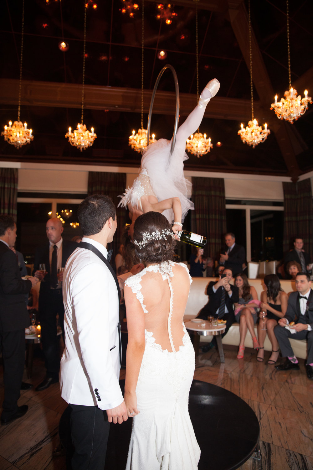 Look at that gorgeous dress! What a great angle to showcase Bride and Groom experiencing our signature Bubbly From Above at their wedding cocktail hour!  Wedding Venue: Westmount Country Club in Woodland Park NJ