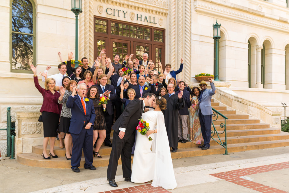 A fun photo of us with our guests. I walk up these steps every day and relive our wedding. It makes going to work more exciting!