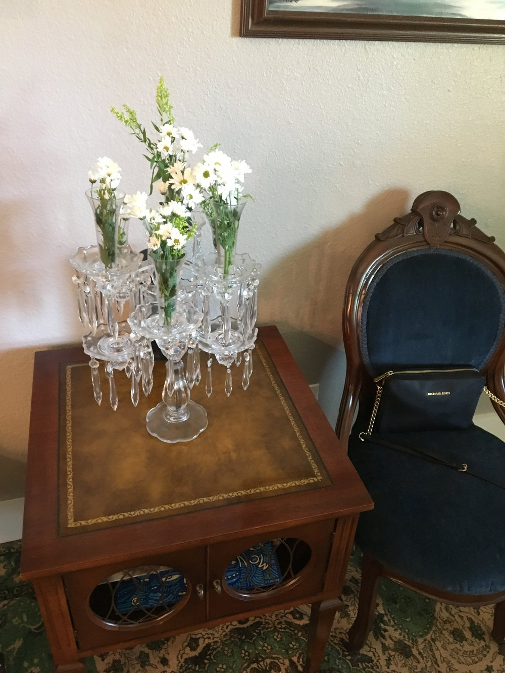 One of my favorite decorative elements were these stunning crystal candelabras my mother-in-law brought over. We will inherit two of these from Baby Marisa Patricia's other namesake, TJ's grandmother. the fresh flowers were a Parisian touch.