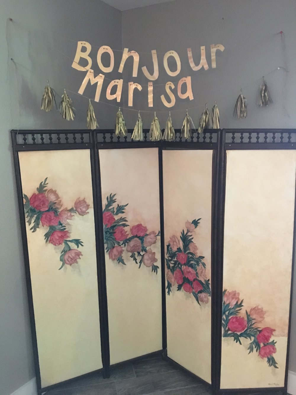 Serving as a photo booth backdrop, this beautiful room divider was hand painted by TJ's grandmother. The cute banner really set the mood and now lives in Baby Marisa's nursery!