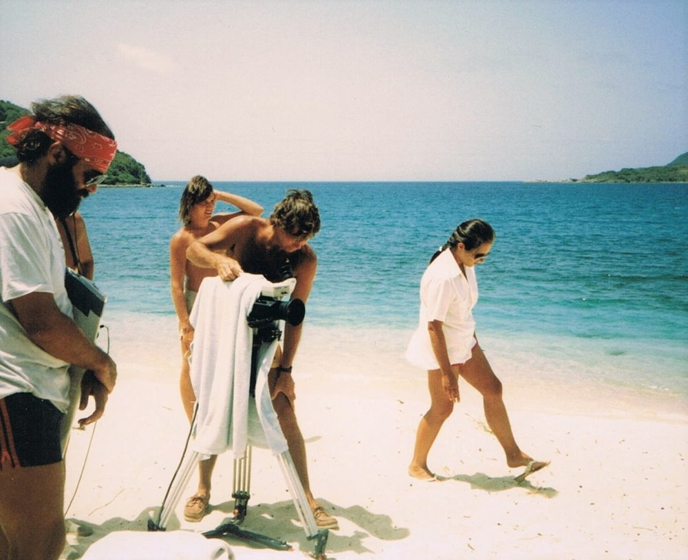 Various crew and equipment at shoot on tropical beach