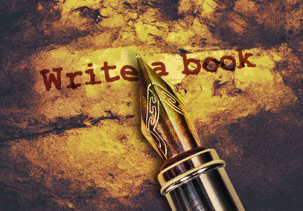 "Fountain pen over the words ""write a book"""