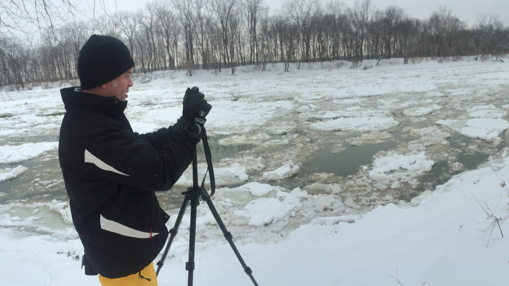 Brendan Kearns photographing the Wabash River.