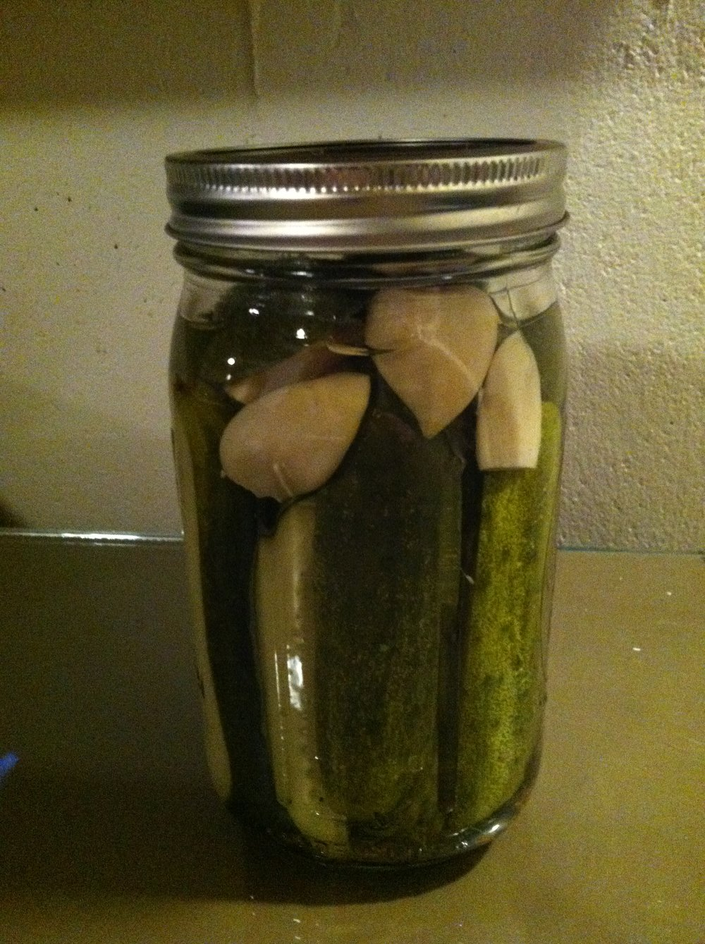 Home-made garlic dill pickles.