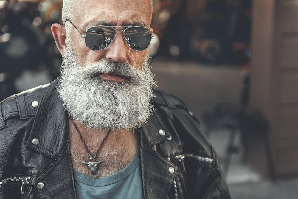 Confident bearded man near garage