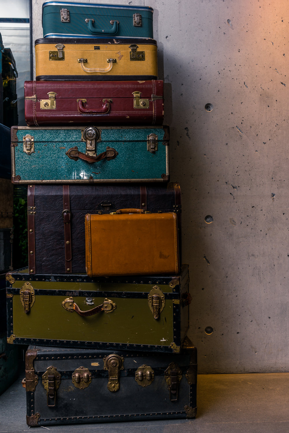Stack of colorful vintage suitcases - 1