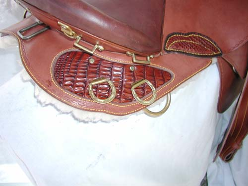 Crocodile skin has been added to the back skirting of this saddle, along with crocodile skin for the thigh patch. Cost of this, as you see it, on both sides of the saddle, is $600