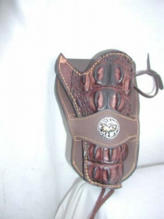 We cover any holster in croc skin, with or without the head. This one does not have the head. Cost of this is $395. With the head (the high quills) is $495