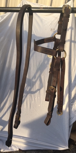 The Barcoo Bridle is actually an English-style headstall, but made with tougher leather for rugged use in the bush -- or on American trails! The life of this piece of equipment, if kept oiled, is about 20 years! Price with reins, $129