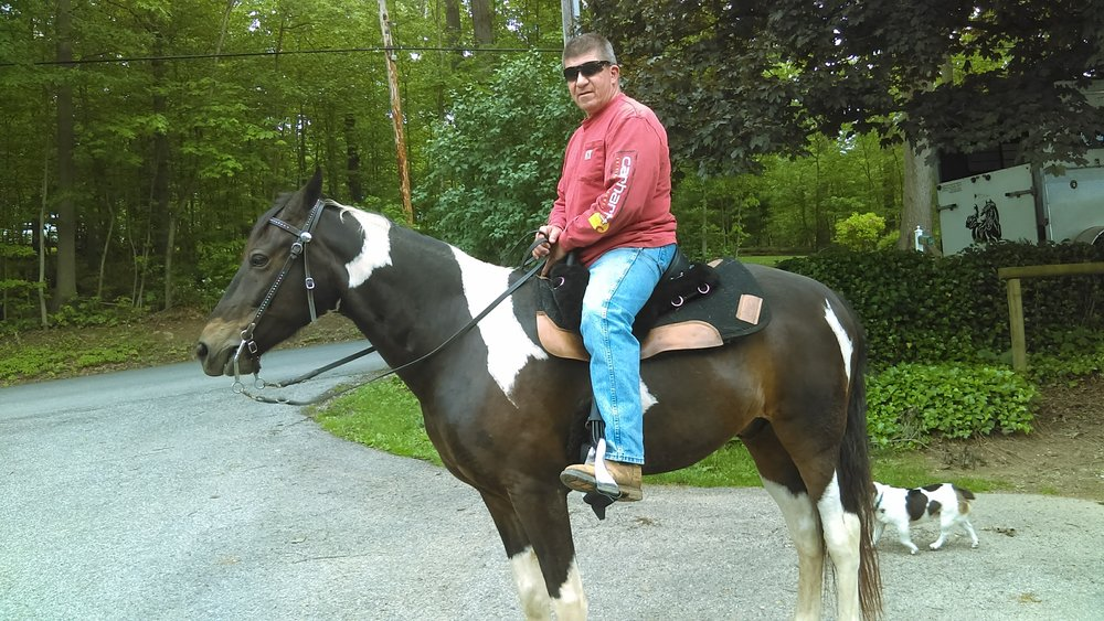 Kristina's husband Wayne and his horse Dillon