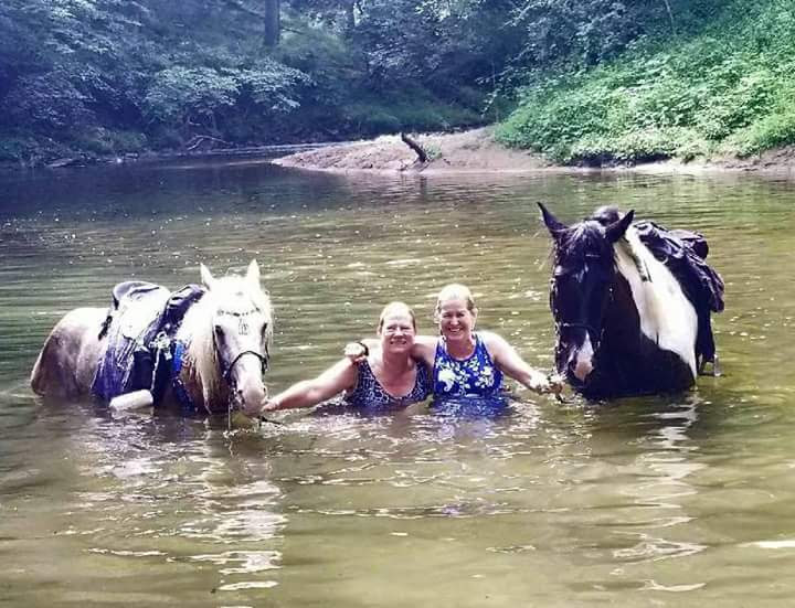 Kristina and Greta in a river with Wyatt and Little Joe