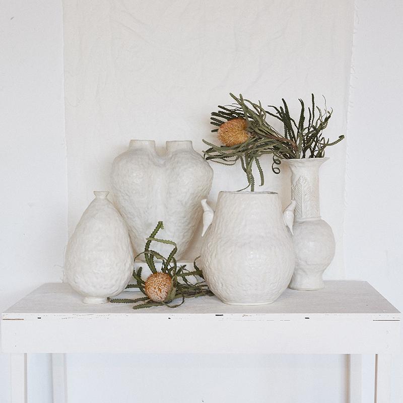 Egg vase (front left): $220  Feather vase (back right): $330