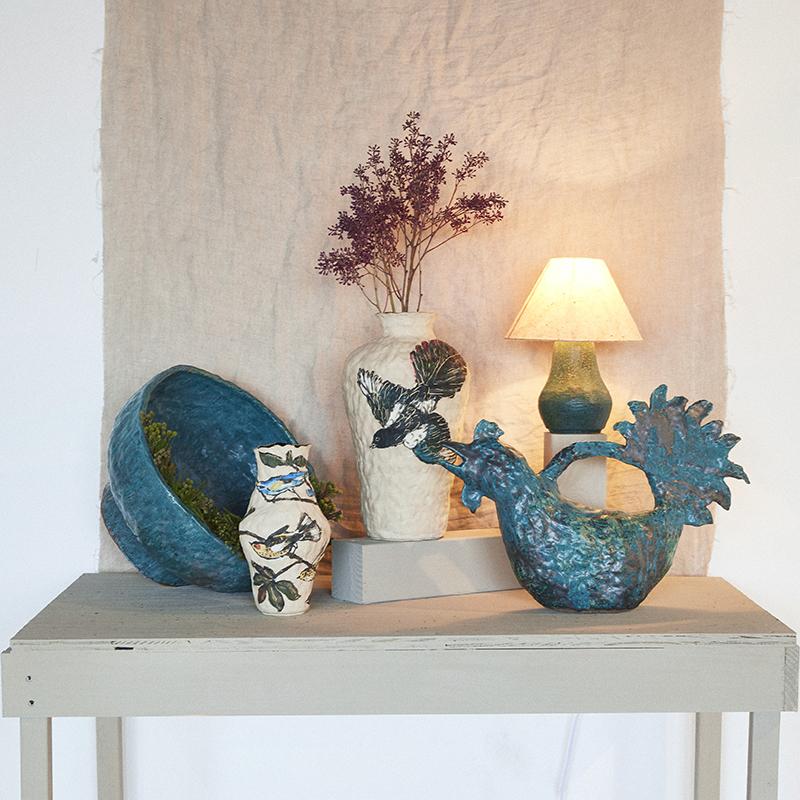 Oversize bowl (back left): $380  Warbler vase (front left): $220  Magpie vase (center): $400  Rooster vase / watering can (front right): $290