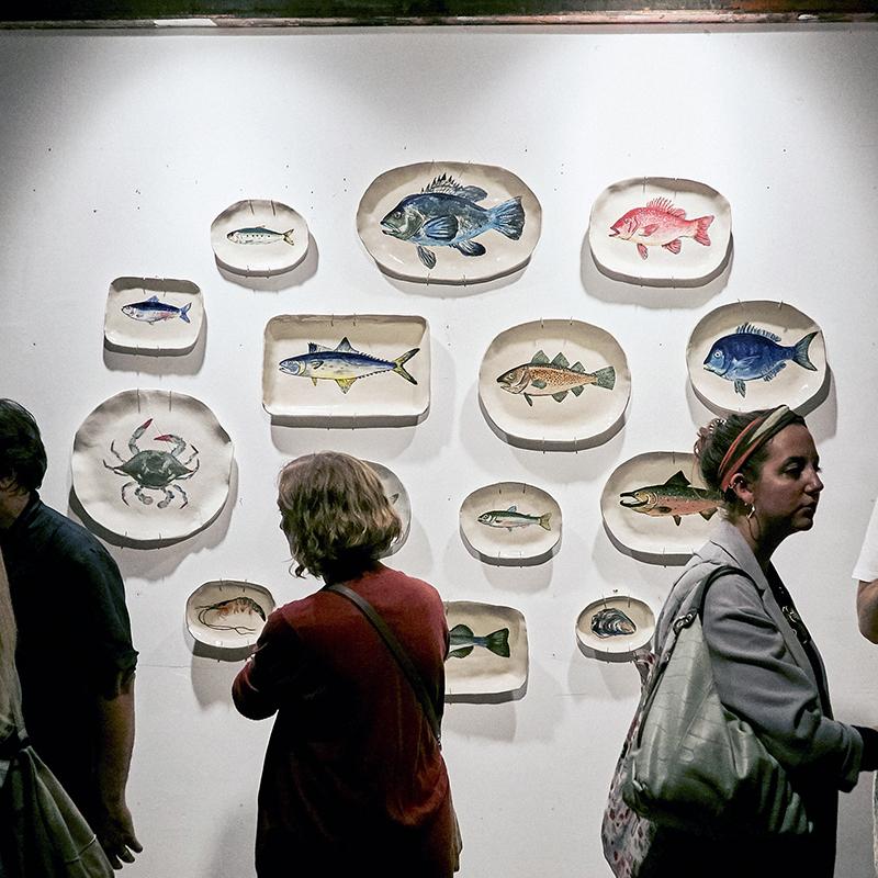 Black sea bass (top row, center): $310  Crab, cracked (third row, far left): $120  Salmon (third row, far right): $310