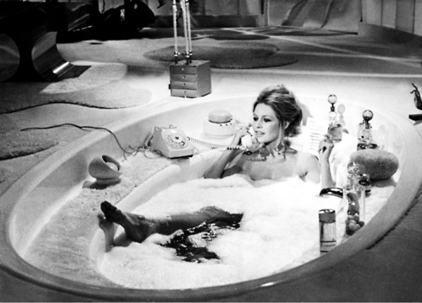 Relax as glamorously as Bardot: Photo via Vogue