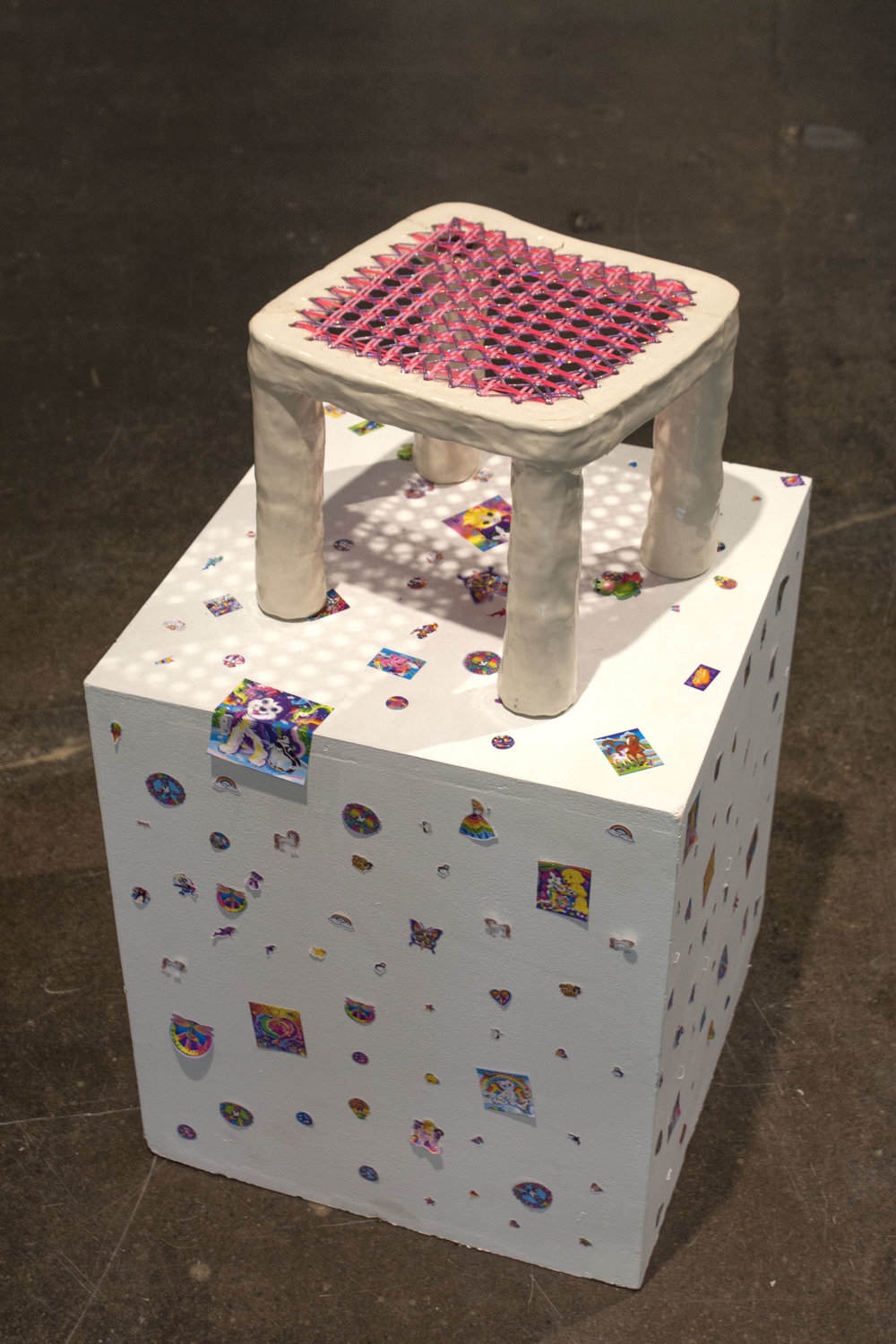 "Stool 1 (Lisa Frank), Ceramic sculpture, palstic lacing cord, 10"" x 10"" x 10"", 2018"