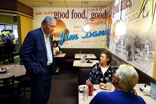 Mark Hurt talks with Cindy and Mike Spencer while on the Senate campaign trail at Tipton's Jim Dandy restaurant on Friday.