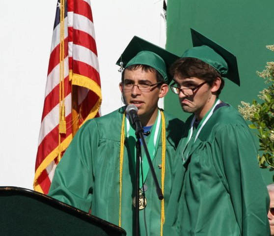 A very young us, delivering a speech at our high school graduation in 2011.