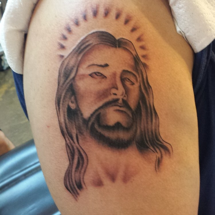 Jesus black and gray shoulder tattoo.