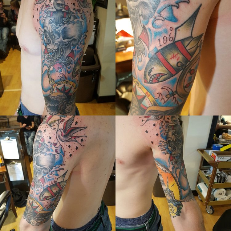 Naval themed half sleeve. Skull, sparrows, bombs, compass, anchor and stars in color  tattoo.