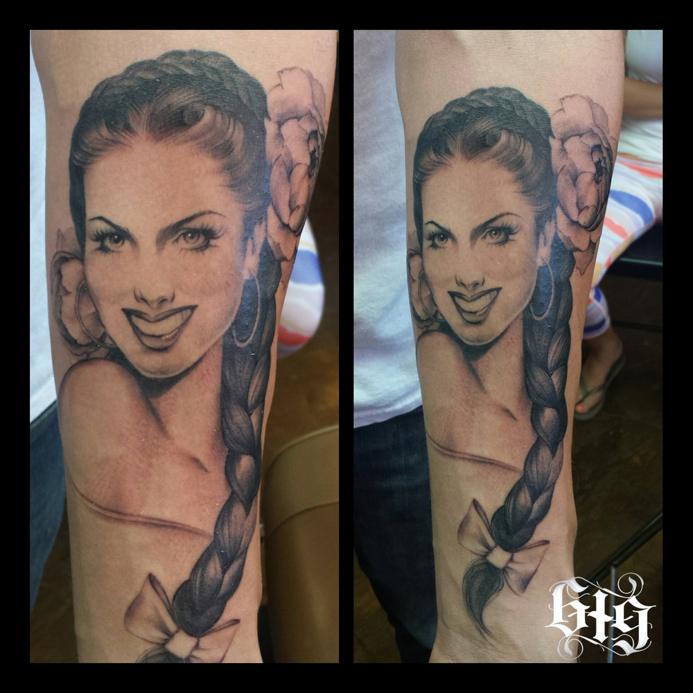 Portrait fine detail black and gray classical Mexican pinup. Half sleeve forearm tattoo.