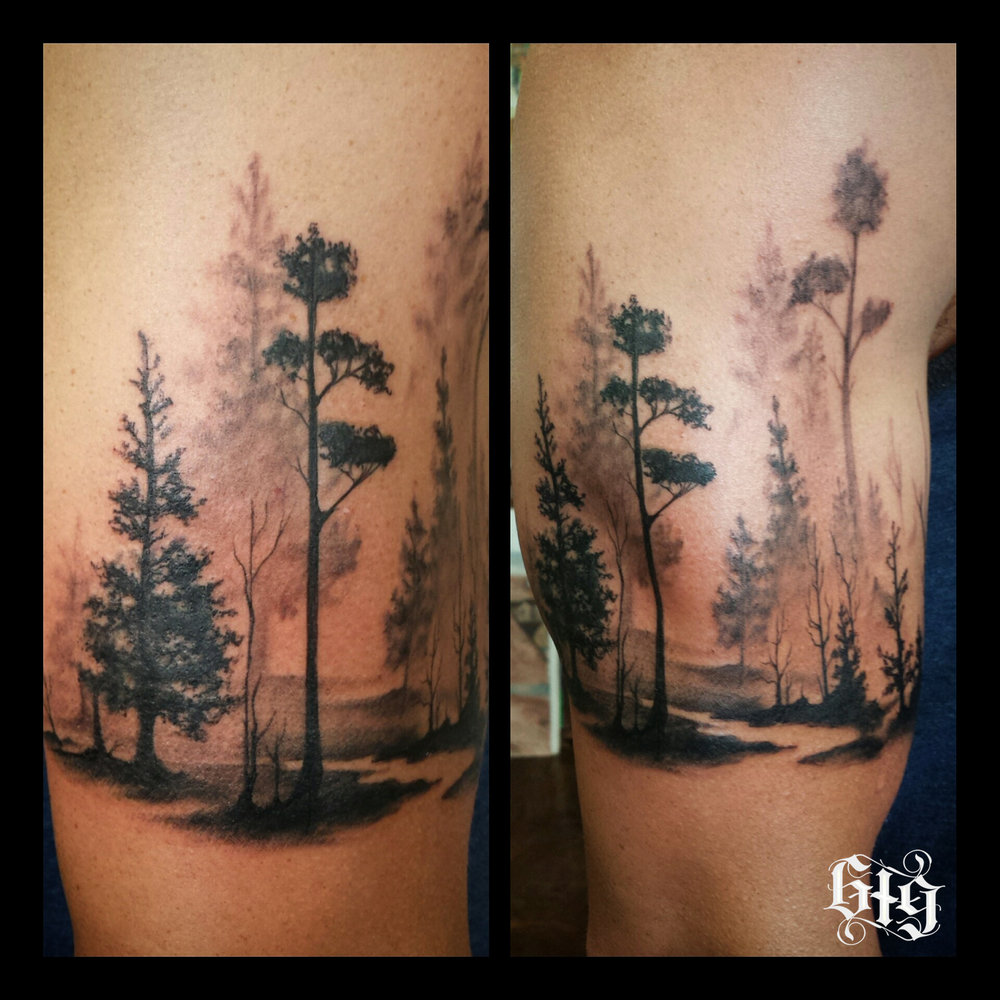Misty Forest.  Black and gray trees fine detail. Upper arm, half sleeve tattoo