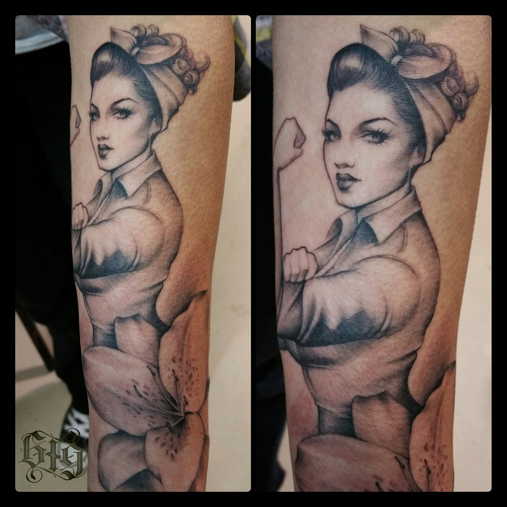 Rosie the Riveter style black and gray pinup with lily. Half arm sleeve tattoo