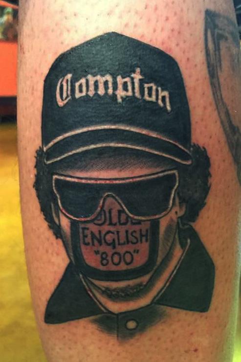 Eazy-E portrait black and gray. Compton NWA theme half sleeve leg tattoo.