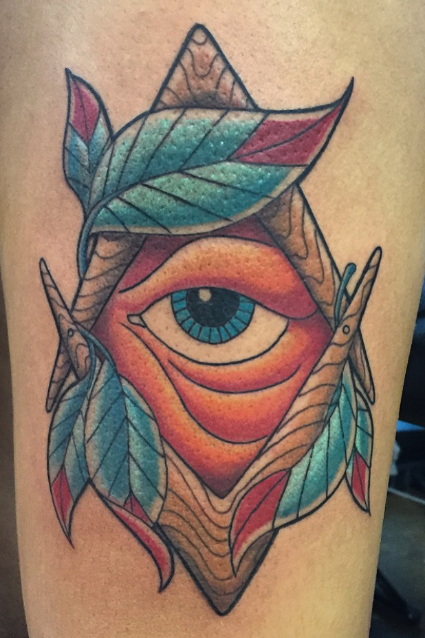 Eye of Providence, Masonic's the All seeing eye with feathers. Lower thigh color tattoo
