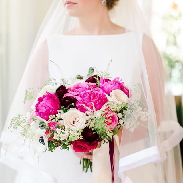 Always crushing on this bold and bright color palette. @sarahtkline effortlessly combined a traditional and timeless look to their beautiful and colorful winter warehouse wedding. { #regram @castophoto } . . . #bride #colorfulwedding #winterwedding #theengineroomga #southernweddings #southernbride #atlantaweddings #floraldesign #winterwedding #warehousewedding #monroega