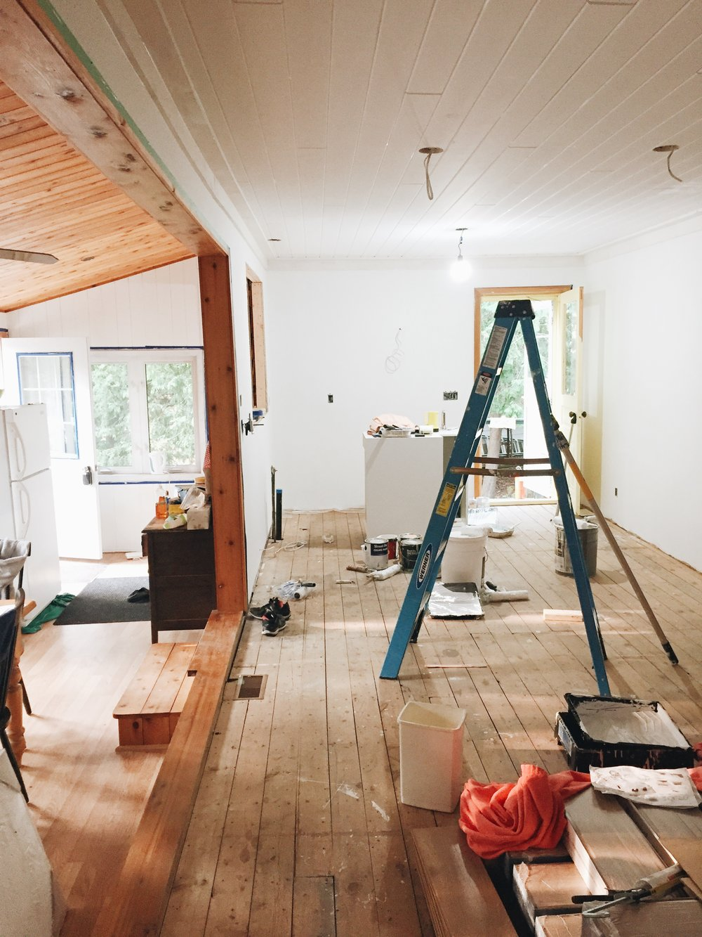 The new drywall is up and painted (Beauti-Tone's 'Here Comes the Bride'), and the opening over the sink has been enlarged! Ceiling are planked and painted.