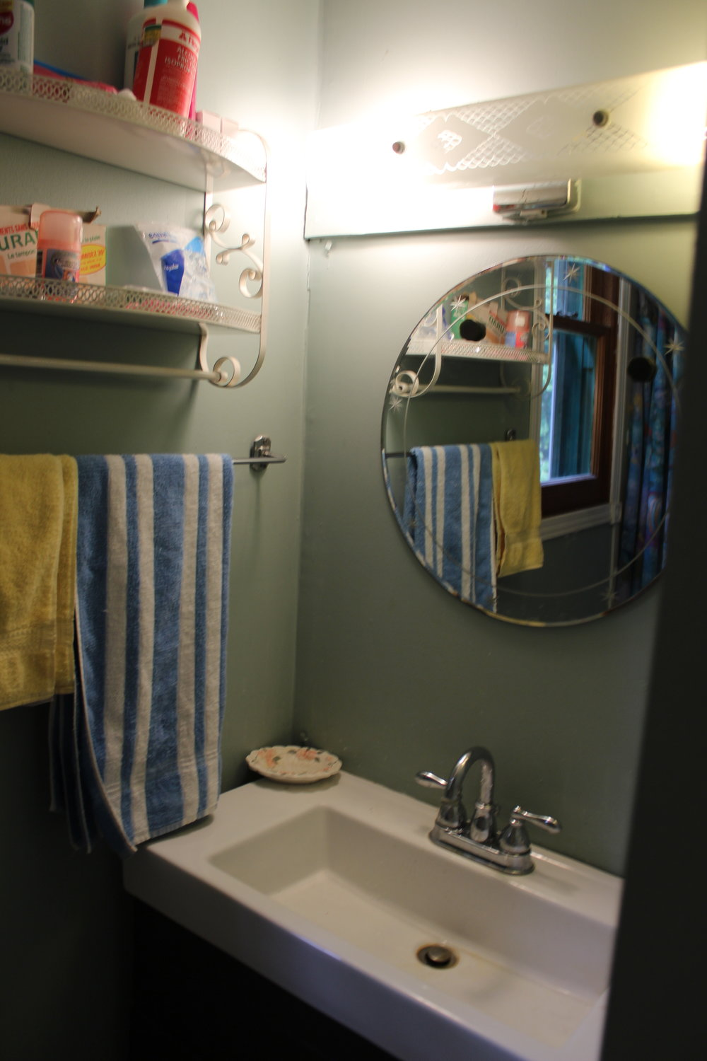 ^Before, to stand at this small vanity, you were literally wedged between the toilet and the sink. There was no real counterspace either, and only one person could be brushing their teeth at a time.