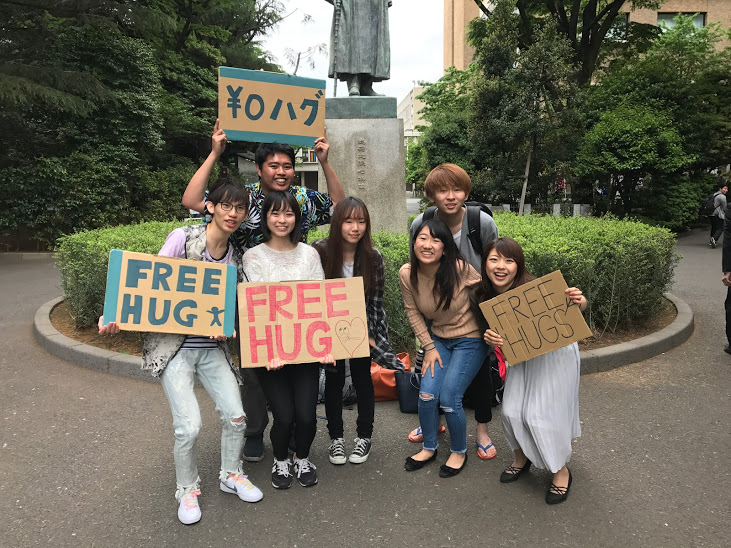 A group of students at Waseda University giving out free hugs.Their hugs and smiles were an incredible way to start the day on the way to the conference!