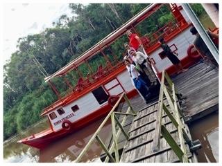 The Rimba Princess klotok docking in front of Rimba Ecolodge