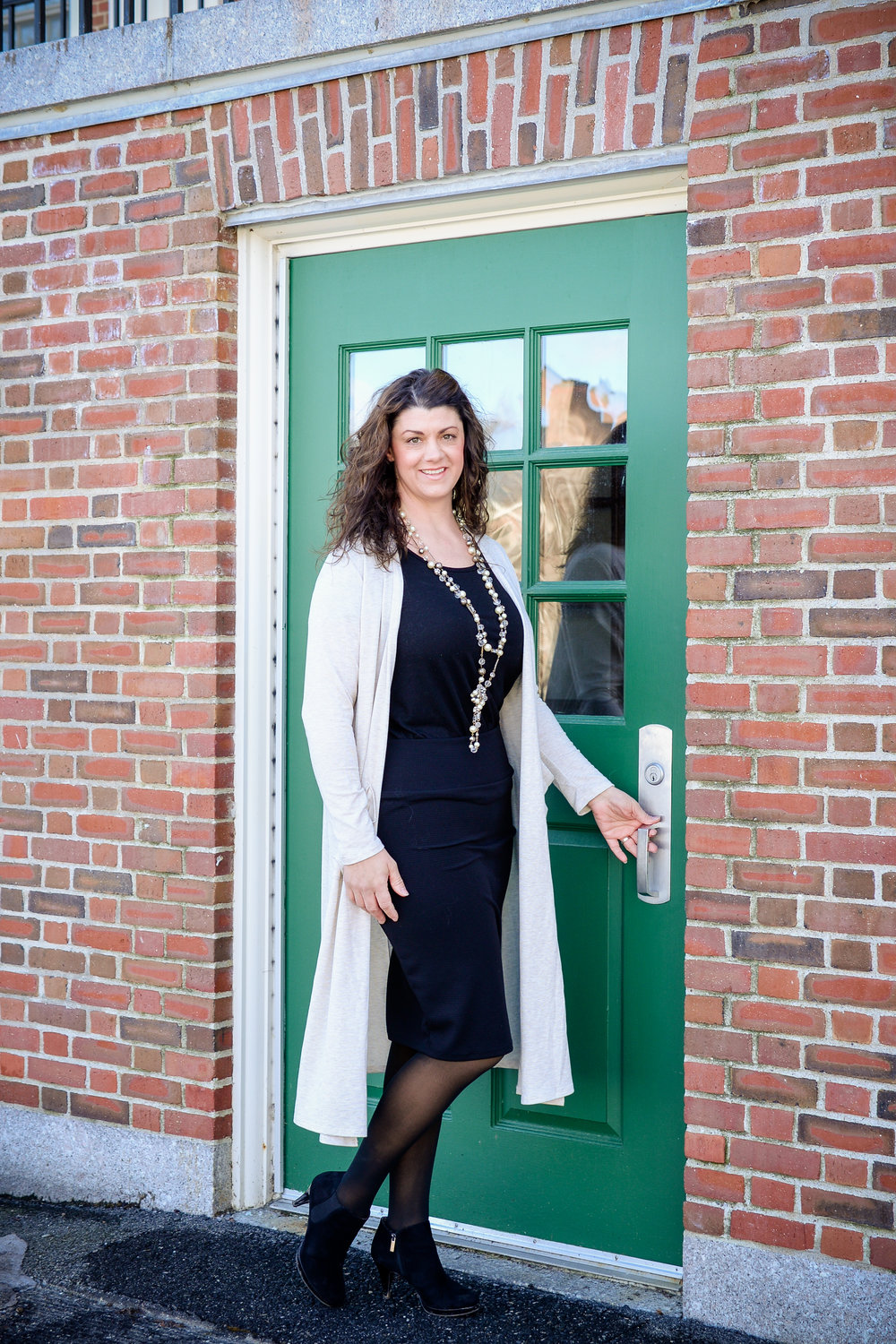 Heather pictured in Cassie pencil skirt, Classic T, and Sarah duster sweater.  Classy, elegant, and professional.  Waterville, Maine Colby College