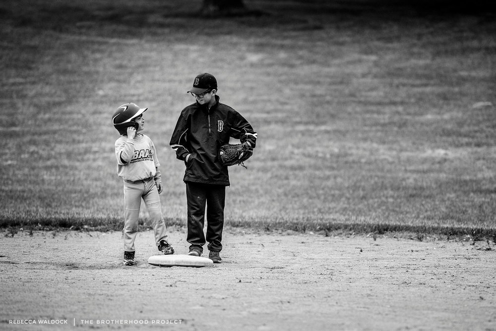 "When your big brother fills in as your first base coach. Sam's baseball team was down a coach.  Jack happened to have a free night.  Being the problem solver that he is, he volunteered his services, because ""someone has to teach these kids about the sport of baseball, otherwise they will just sit there are make sand castles in the infield and watch airplanes go over in the outfield.""    All Sam wanted was a base hit. He didn't want a double or a triple.  He wanted to stop at first base.  He wanted to be there with his big brother and get advice. He wanted the fist bump and to hear his big brother say, ""nice hit."" Jack enjoyed being the guy who told the kids when to hold up and when ""to run to second base like the boogey man was chasing you."" Luckily, the short stop on the other team was busy making sand castles and watching airplanes go by, and Sam got his base hit. He would have stayed on first base all night."
