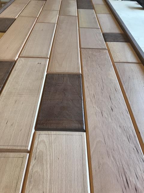 Headboard made of solid walnut and beechwood.