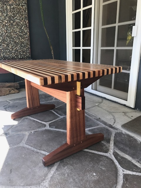 Outdoor table made out of African Mahogany and maple with Yellow Heart wedges.    The table comes apart in four pieces.