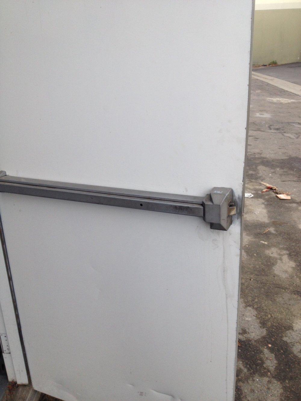 Push bar stuck in the unlocked position.