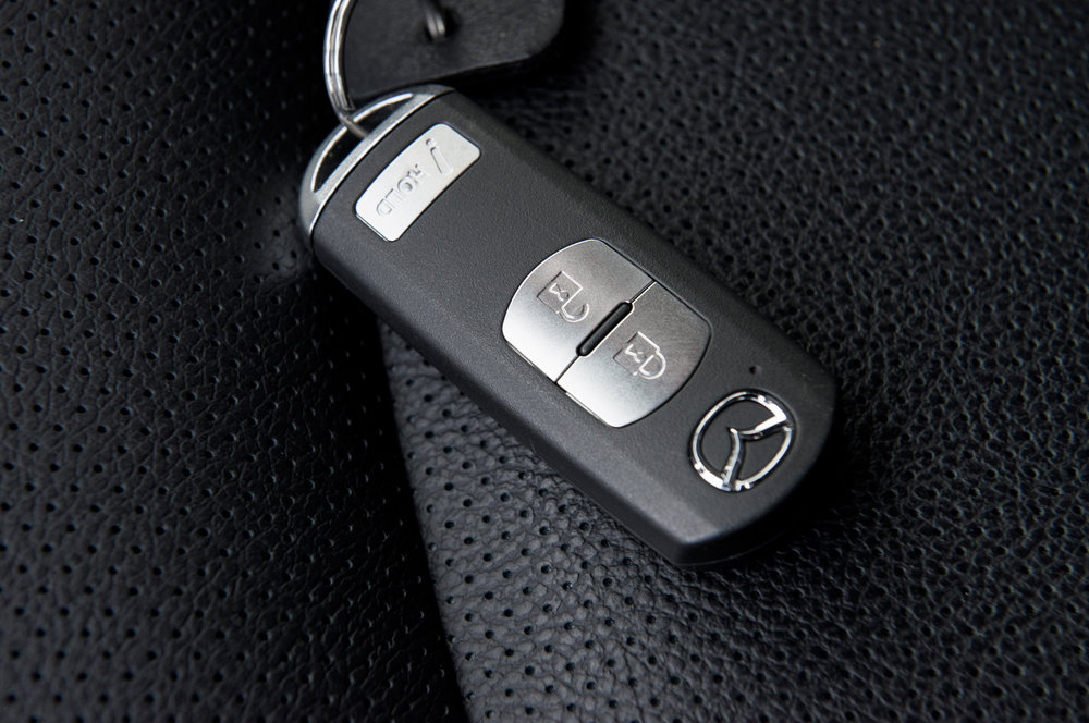 QLP Locksmith San Diego programs smart keys for Mazda, also QLP Locksmith cuts the emergency key blade for a low price! This is a smart key for push to start Mazda and for proximity entry. (Pressing the button on the handle if equipped to unlock the car)