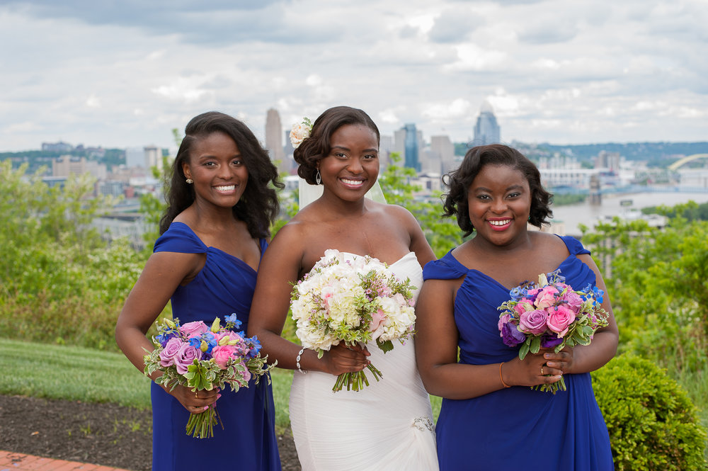 From left to right, Bride's maid hair: Natural blow out with curls, Bride's hair: Full extensions with updo, and Bride's maid hair: Relaxer and wand curls. Photography by: Locke Innovations