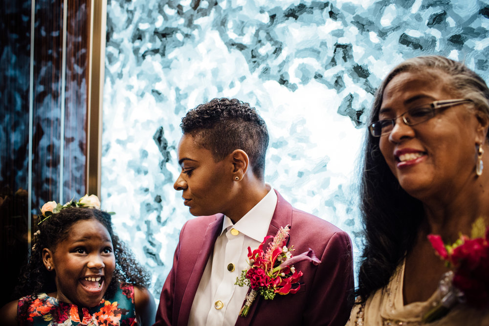 From left to right, Flower girl: Floral halo with twists and natural curls, Bride: Taper cut with carver's part, Mother of the Bride: Natural Blowout with silk press. Photography by: BEST DAY EVER & Cassandra Zetta