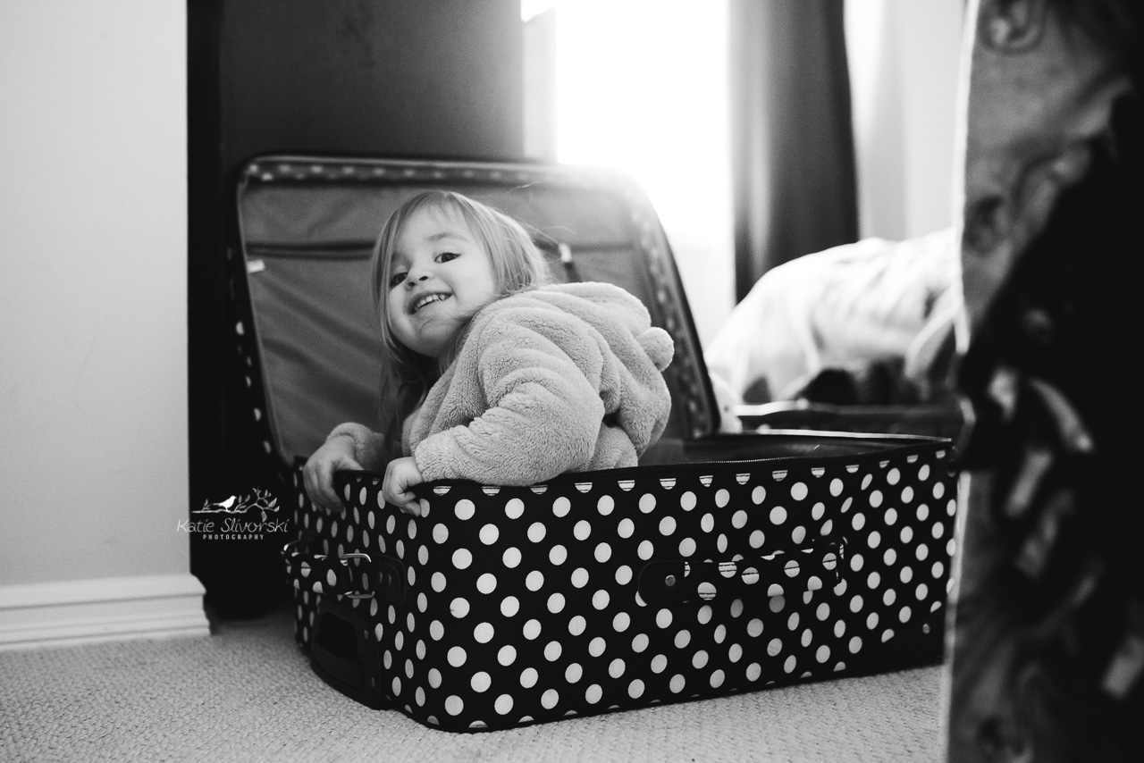girl sitting in suitcase