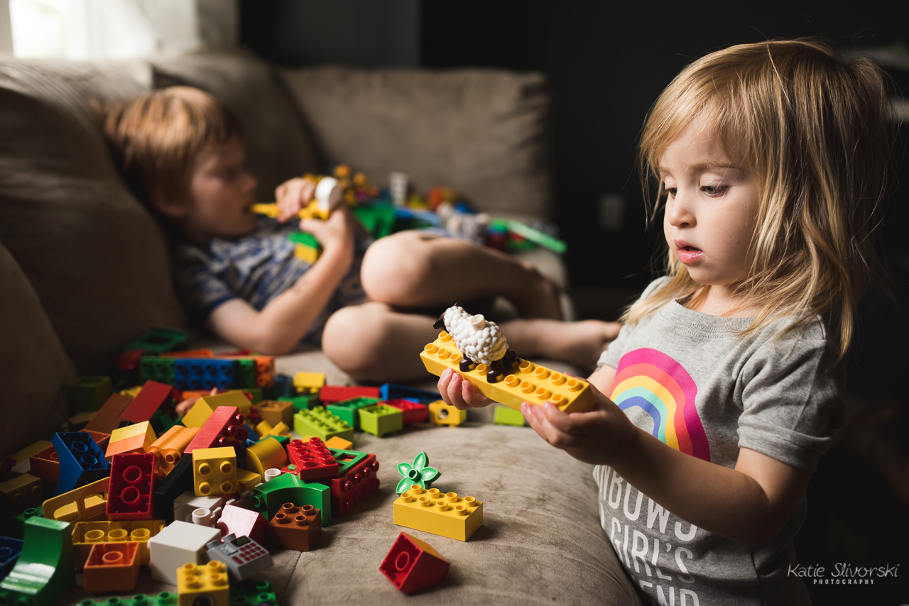 a documentary photo of kids playing with duplo