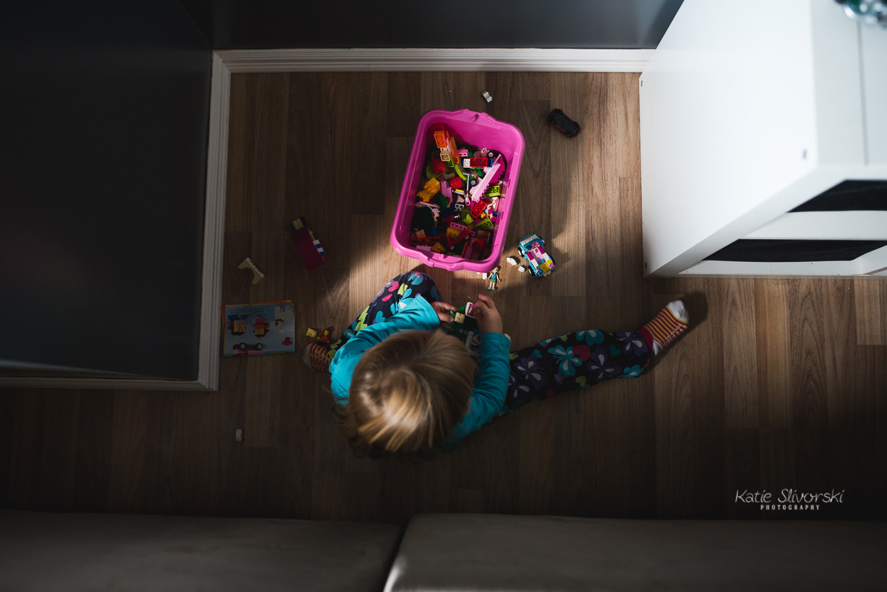 Edmonton documentary photo of a girl playing with Lego