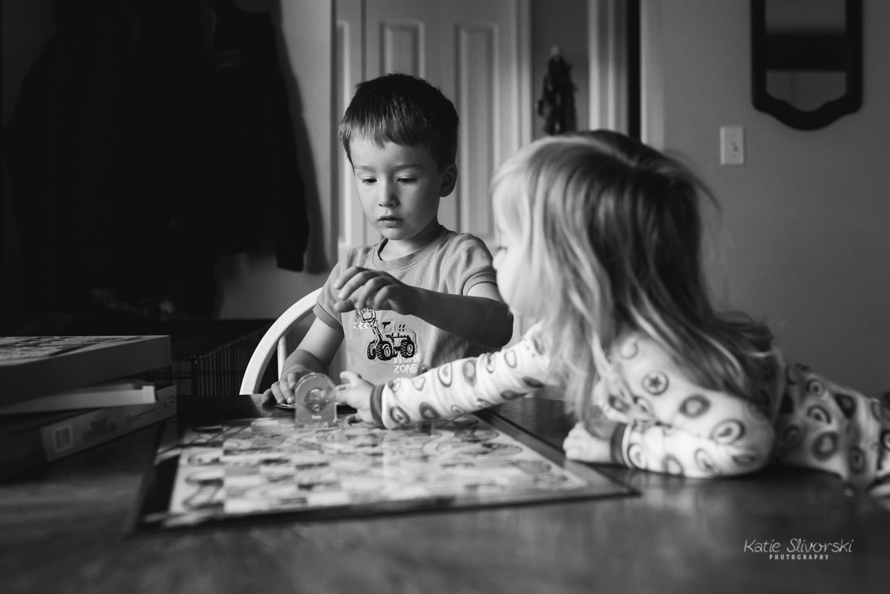 photo of  kids playing a board game
