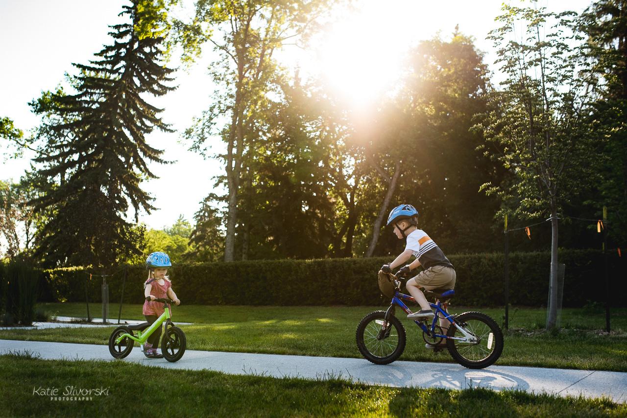A photo of two kids biking in Edmonton